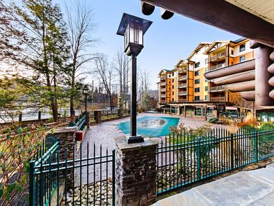 Photo for Comfortable downtown condo w/ jetted tub, fireplace & shared hot tub/pool!