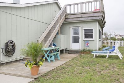 Outdoor side deck area offers a water hose, picnic area and outdoor shower.