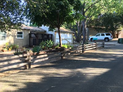 Photo for Country in the City- Close proximity to freeways- Quaint home, large Green Oasis