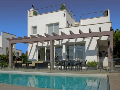 Photo for This 4-bedroom villa for up to 9 guests is located in Son Bou, Menorca and has a private swimming po