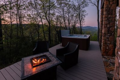 Back deck with incredible mountain views.  - Fire table with swivel/rocking chairs, along with hot tub (railing has been added as of May 2018).