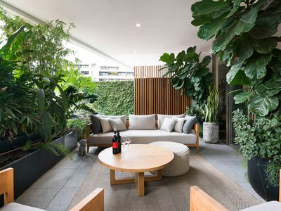 Photo for Luxury garden apartment in resort style building