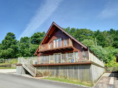Photo for Detached holiday home made of Canadian wood, with an open fireplace and nice balconies