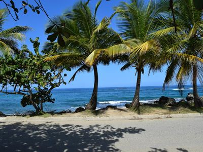 Photo for Relaxed Oceanfront home on quiet palm fringed Beach with large Oceanfront patio