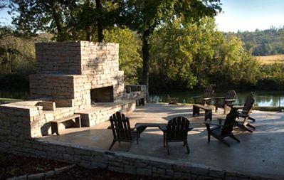 Hand-laid natural stone outdoor fireplaces overlooking Terrapin Creek