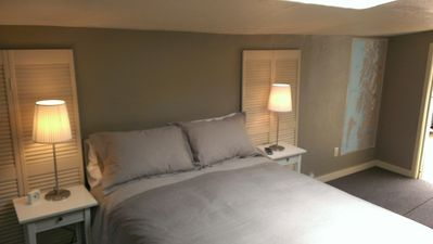 Master Bedroom with a comfortable queen size bed and flat screen tv.