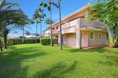 Shaka Hale - Lovely landscaped yard with a variety of palms and tropical foliage.