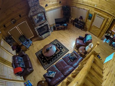 Upscale living room with cozy leather furniture, 50 ' smart tv & surround sound