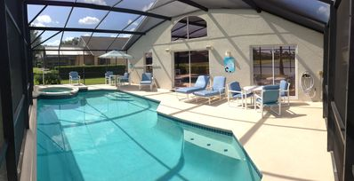 lPool Deck Area.  Pool furniture includes 4 lounge chairs, 8 chairs, 2 tables