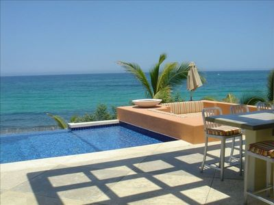 Infinity Pool Blends with the Ocean~~Sunken Firepit and Torch on the Right