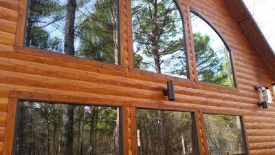 The towering pines are reflected in our wall of beautiful windows.