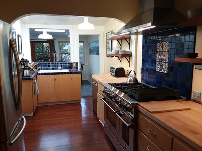 kitchen leads to dining room and back yard