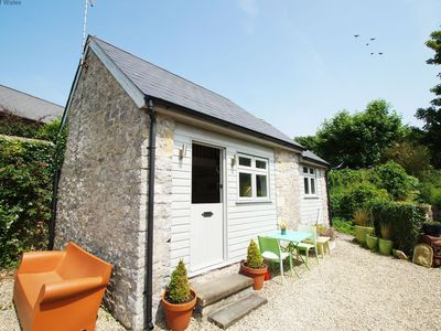 Photo for Get the best of both worlds in this peaceful and quaint cottage in a sleepy Welsh hamlet that is onl