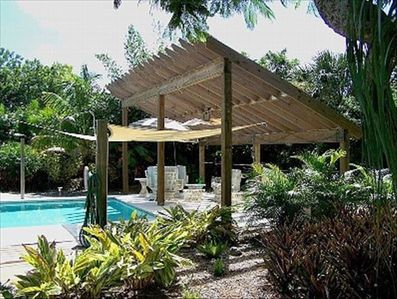Covered pool patio, solar panels heat pool