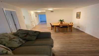 Photo of the living room and dining area with new wood floors
