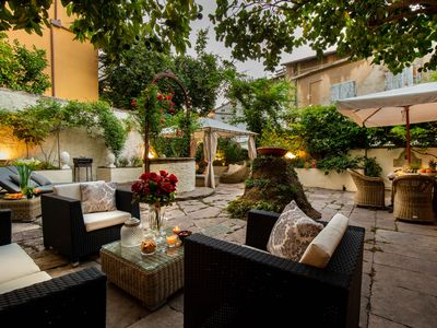 Photo for Charming Apartment with Garden overlooking the Cathedral inside the Lucca Walls
