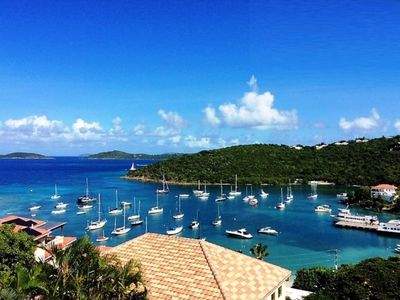 Photo for Very Popular  Walk to Cruz Bay in this High-End Condo with stunning views from porch!