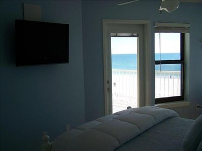 Master Bedroom with LCD HD TV and Direct Gulf Front View. king bed
