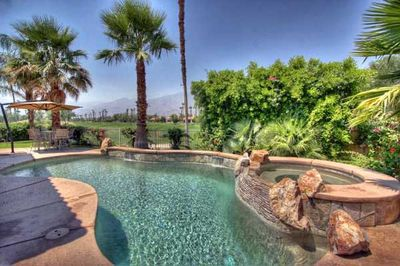 Pool and spa with golf course and mountain views