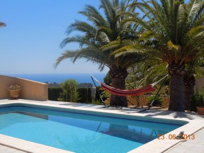 Photo for House with pool, garden, sea and mountain views near Golf