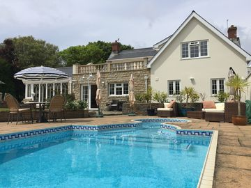 Luxury home with heated pool and spa in beautiful private and mature gardens