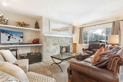 Cozy and bright living room, open to dining and kitchen and includes spectacular views of Vail Mountain.