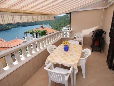 Photo for Two bedroom apartment with terrace and sea view Duga Luka (Prtlog), Labin (A-5528-b)