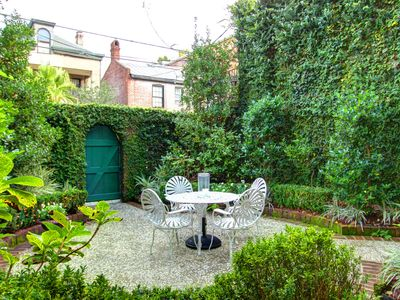Photo for Beautiful Courtyard! Classy, Cozy Garden Level Property!