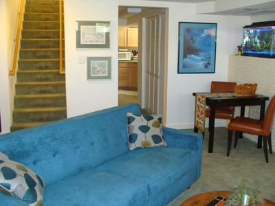 Open living area with a comfy queen sofa-bed!