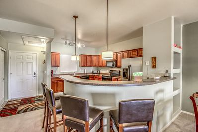 Enter into this large open kitchen with a nice breakfast bar and everything you'll need.