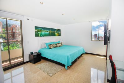 Master Bedroom with King size bed,flat screen tv,private bath and balcony