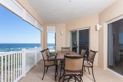 Breezes and Views in Two Directions on The Big Covered Balcony at 452 Cinnamon Beach! - Relax on our balcony and enjoy the sea breeze and sweeping views of the Atlantic Ocean and Ocean Hammock Golf Course. The free WiFi works out here, so it's a grea