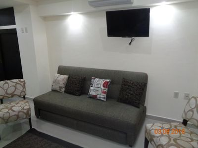 Living area with flat screen HD TV, WIFI and double sleeper sofa