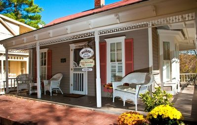 Photo for The Best Historic District Victorian Cottage in Eureka Springs