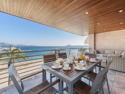 Photo for Frontline line apartment located on the beach in Port de Pollensa