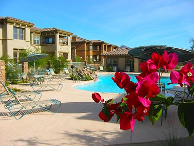 Beautiful flora and waterfalls surround heated pool and spa steps away!