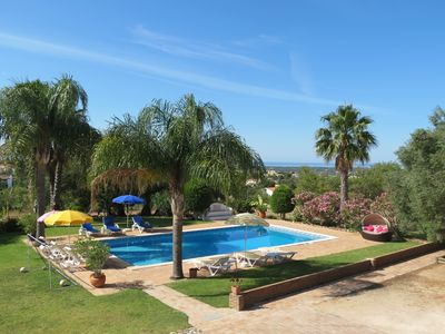 Pool area and Garden with view to the sea