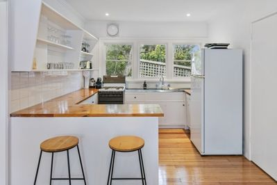 Upstairs sunny, functional kitchen has everything you need.