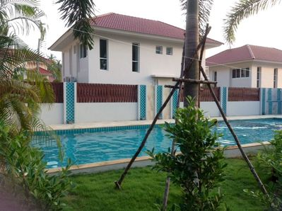 Residence swimming pool in front of house