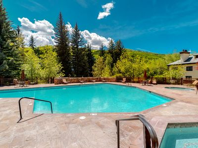 Photo for Ground floor ski-in/ski-out condo w/ fireplace & shared pool and hot tubs!