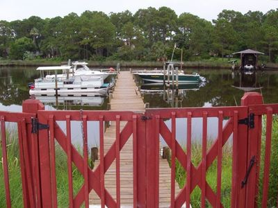 Photo for Private Dock - Ground Floor - Poolside - Walk to the Beach