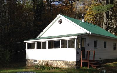 The front of the cabin with porch overlooking the lake
