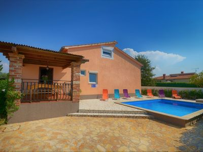 Photo for Modern apartment located on the ground floor with shared pool, near Porec