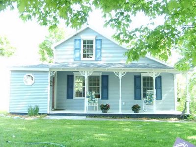 Front view of house and porch in the charming village of Northport.