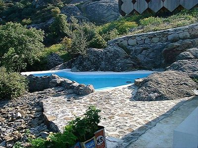 Village cottage private dipping pool and sunning area; cut from stone