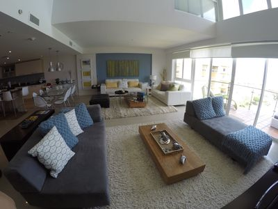 living space with big windows for a spectacular beach view (pools too)!