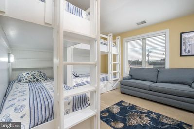Kids will love this room!  Built-in bunk room w storage and queen sleep sofa.