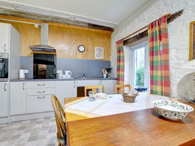 Photo for A rustic old stone cottage, simply furnished but with modern conveniences, The Bakery is a single st