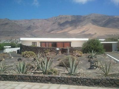 Photo for Bungalow KIRITEN in Famara for 4 persons with terrace, garden, views to the ocean, WIFI on the go and less than 100m to the sea