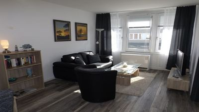 Photo for Bright and modern apartment right on the North Sea